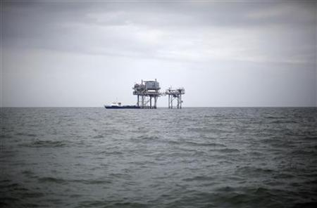 A drilling platform is seen near Breton Island, Louisiana May 3, 2010. REUTERS/Carlos Barria