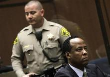 <p>Doctor Conrad Murray, the late Michael Jackson's personal physician, listens during his arraignment on a charge of involuntary manslaughter in the pop star's death, in Los Angeles, January 25, 2011. REUTERS/Pool/Irfan Khan</p>