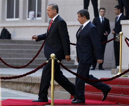 Turkey's Prime Minister Tayyip Erdogan and Foreign Minister Ahmet Davutoglu arrive at a ceremony in Ankara, September 6, 2011. REUTERS/Umit Bektas