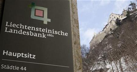 A sign marks the entrance of the headquarters of the Liechtensteinische Landesbank bank as Vaduz Castle is seen beside in the country's capital Vaduz February 18, 2009. REUTERS/Arnd Wiegmann