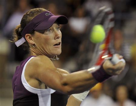Samantha Stosur of Australia returns volley to Angelique Kerber of Germany during their semi-finals match at the U.S. Open tennis tournament in New York, September 10, 2011. REUTERS/Ray Stubblebine