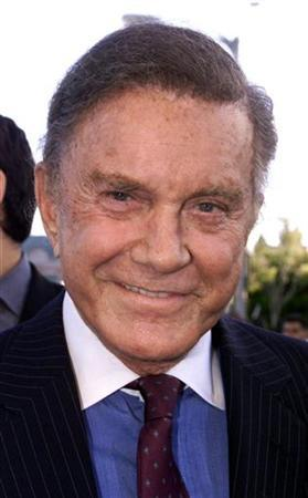 Actor Cliff Robertson, one of the supporting cast of the new action adventure film ''Spider-Man'' poses at the films premiere, April 29, 2002 in Los Angeles. REUTERS/Fred Prouser