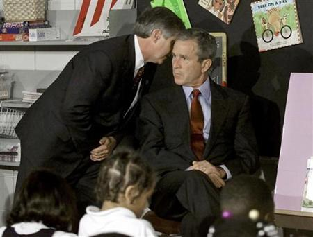 President George W. Bush listens as White House Chief of Staff Andrew Card informs him of a second plane hitting the World Trade Center while Bush was conducting a reading seminar at the Emma E. Booker Elementary School in Sarasota, Florida in this September 11, 2001 file photo. REUTERS/Win McNamee/Files