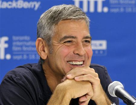 Actor George Clooney smiles during the news conference for the film ''The Descendants'' at the 36th Toronto International Film Festival September 10, 2011. REUTERS/Mike Cassese