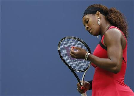 Serena Williams of the U.S. reacts to a missed point to Samantha Stosur of Australia during their finals match at the U.S. Open tennis tournament in New York, September 11, 2011. REUTERS/Lucy Nicholson