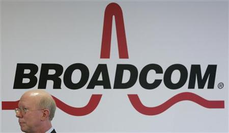 Broadcom Corporation President and Chief Executive Officer Scott McGregor stands in front of the company's logo in Taipei March 18, 2010. REUTERS/Pichi Chuang
