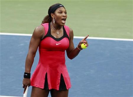 Serena Williams of the U.S. argues with the chair umpire during her match against Samantha Stosur of Australia in the finals at the U.S. Open tennis tournament in New York, September 11, 2011. REUTERS/Jessica Rinaldi