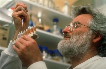 Dr John Sulston, Director of the Sanger Centre near Cambridge takes part in the Human Genome Project in this undated handout photo. REUTERS/Handout