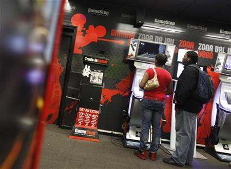 People play video games inside a GameStop retail store in New York March 18, 2010. REUTERS/Shannon Stapleton