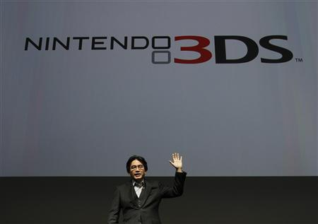 Nintendo President Satoru Iwata waves during the Nintendo 3DS Conference 2011 in Tokyo September 13, 2011. REUTERS/Toru Hanai