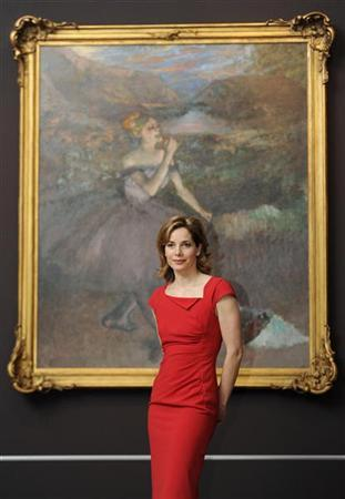 Darcy Bussell, former principal dancer at the Royal Ballet poses in front of ''Dancer with Bouquets'' by Edgar Degas at the Royal Academy of Arts in London September 13, 2011. REUTERS/Paul Hackett