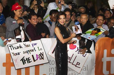 Cast member Michelle Yeoh greets fans on the red carpet for the film ''The Lady'' during the 36th Toronto International Film Festival (TIFF) September 12, 2011. REUTERS/Mark Blinch