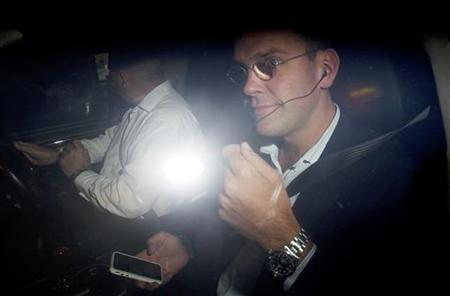 News International Chairman James Murdoch leaves the company headquarters in Wapping, London, July 11, 2011. REUTERS/Olivia Harris
