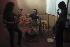 <p>Iranian musicians Ramin Rahimi (C), Mahyar Dean (L) and musician and sound engineer Farshid play music at a music studio in Tehran July 17, 2011. Many Iranian bands do not bother asking for the mandatory government permits to release their music and seek contracts with foreign companies or put their music on websites blocked by the state but still accessible to anyone with a modicum of technical nous. REUTERS/Morteza Nikoubazl</p>