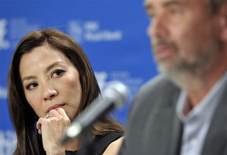 Malaysian actress Michelle Yeoh listens to French director Luc Besson speak during a news conference for the film ''The Lady'' at the 36th Toronto International Film Festival September 12, 2011. REUTERS/Mike Cassese