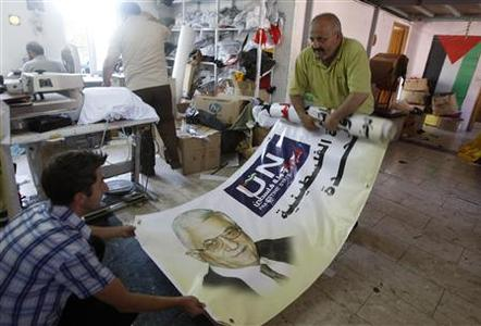 Palestinians prepare a banner depicting Palestinian President Mahmoud Abbas at a workshop in the West Bank city of Nablus September 14, 2011, as part of the campaign supporting the Palestinians' bid for statehood at the United Nations. REUTERS/Abed Omar Qusini