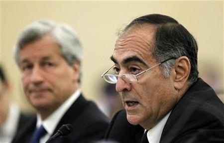 John Mack (R), chairman of Morgan Stanley, testifies before the Financial Crisis Inquiry Commission, as Jamie Dixon, chief executive of JPMorgan Chase, awaits his turn to speak in Washington January 13, 2010. REUTERS/Kevin Lamarque