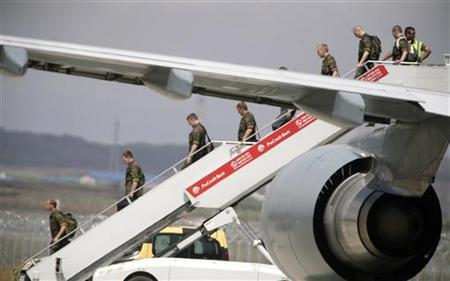 NATO peacekeepers from Germany arrive at the airport in Pristina, August 5, 2011. REUTERS/Hazir Reka
