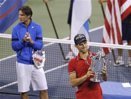 Novak Djokovic of Serbia (R) and Rafael Nadal of Spain hold their trophies during the presentation ceremony after Djokovic won the men's final of the U.S. Open tennis tournament in New York, September 12, 2011. REUTERS/Eduardo Munoz