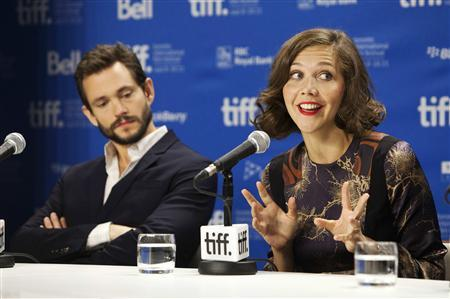 Cast member Maggie Gyllenhaal speaks next to Hugh Dancy (L) during the news conference for the film ''Hysteria'' during the 36th Toronto International Film Festival (TIFF), September 15, 2011. REUTERS/Mark Blinch