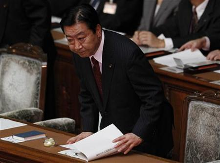Japanese Prime Minister Yoshihiko Noda bows before delivering his first speech to parliament since taking office in Tokyo September 13, 2011. REUTERS/Yuriko Nakao