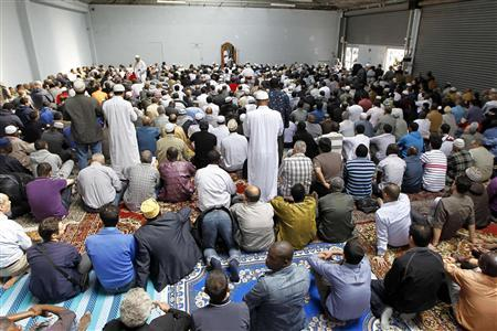 Muslims gather to celebrate Friday prayers inside a large room at a former fire brigade in Paris September 16, 2011. REUTERS-Charles Platiau