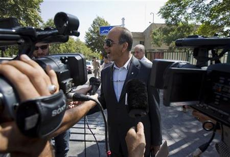Masoud Shafie, lawyer for the three U.S. hikers charged with spying after they were arrested near Iran's border with Iraq, talks to the media outside the revolutionary court in Tehran September 17, 2011. REUTERS/Morteza Nikoubazl