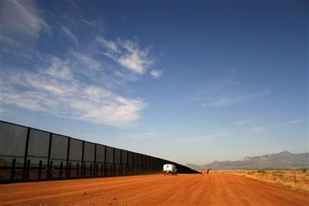 A U.S. Border vehicle drives along the U.S. and Mexico border fence in Naco, Arizona September 7, 2011. REUTERS/Joshua Lott