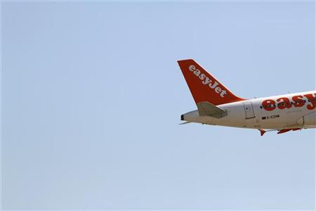 An EasyJet aircraft takes off from Pablo Ruiz Picasso Airport in Malaga, southern Spain, August 29, 2009. REUTERS/Jon Nazca
