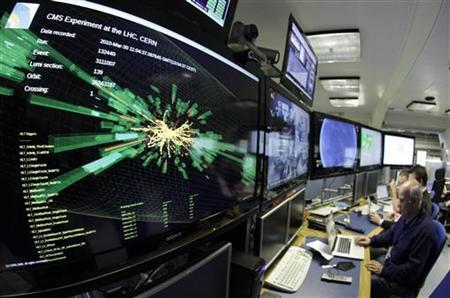 A graphic showing a collision at full power is pictured at the Compact Muon Solenoid (CMS) experience control room of the Large Hadron Collider (LHC) at the European Organisation for Nuclear Research (CERN) in Meyrin, near Geneva March 30, 2010. REUTERS/Denis Balibouse