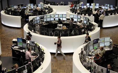 Traders work at their desks in front of the DAX index board at Frankfurt's stock exchange September 9, 2011. REUTERS/Remote/Pawel Kopczynski