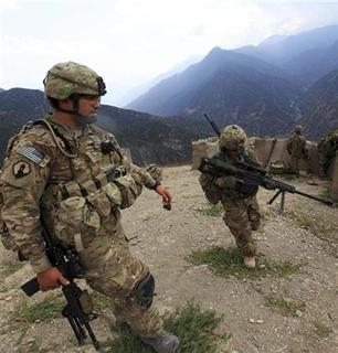 U.S. Army soldiers from Alpha Company 2nd battalion 27th infantry (the Wolfhounds), Task Force No Fear climb upon arrival to Observation Post Mace from FOB Bostick in eastern Afghanistan Naray district, Kunar province near border of Pakistan August 26, 2011. REUTERS/Nikola Solic