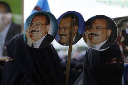 Women take part in a demonstration to show support to Yemen's President Ali Abdullah Saleh (pictured in posters) in Sanaa September 15, 2011. REUTERS/Khaled Abdullah/Files