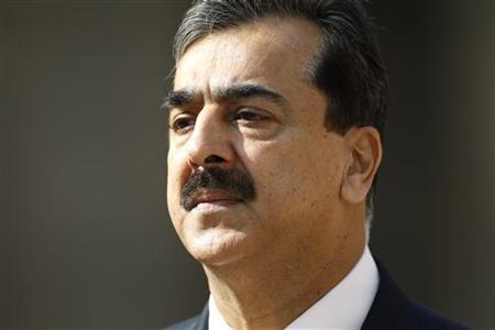 Pakistan's Prime Minister Yusuf Raza Gilani reviews the troops during a ceremony at the Invalides in Paris May 3, 2011. REUTERS/Charles Platiau