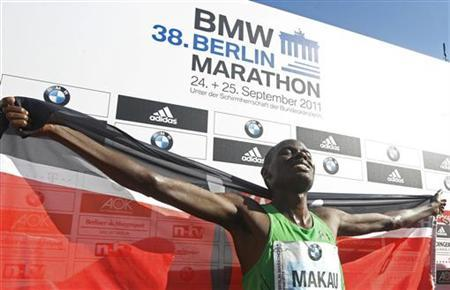 Patrick Makau of Kenya celebrates after winning the 38th Berlin Marathon in Berlin, September 25, 2011. REUTERS/Tobias Schwarz