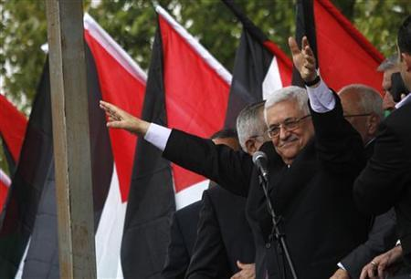 Palestinian President Mahmoud Abbas waves to the crowd during a celebration in the West Bank city of Ramallah, upon his return from the U.N. General Assembly in the U.S., September 25, 2011. REUTERS/Darren Whiteside
