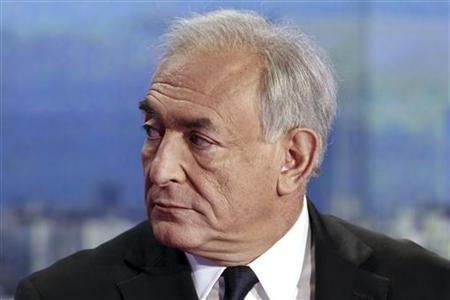 Dominique Strauss-Kahn, former International Monetary Fondation chief (IMF), reacts on the TF1 prime time news programme in their studios in Boulogne-Billancourt, near Paris, September 18, 2011. REUTERS/Francois Guillot/Pool