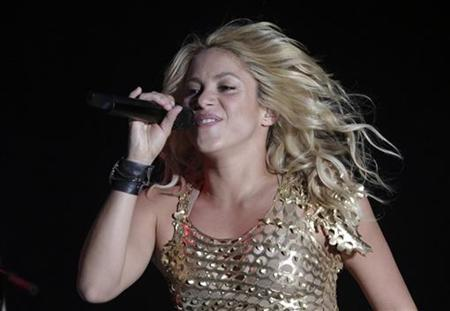 Colombian pop star Shakira performs during her concert as part of ''The Sun Comes Out World Tour'' in Puebla July 24, 2011. REUTERS/Imelda Medina