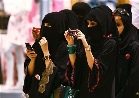Veiled Saudi women take photos of their children during a ceremony to celebrate Saudi Arabia's Independence Day in Riyadh in this September 23, 2009 file photograph. REUTERS/Fahad Shadeed/Files