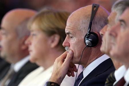 German Chancellor Angela Merkel and Greek Prime Minister George Papandreou attend a meeting of the BDI (Federational German Industries) in Berlin, September 27, 2011. REUTERS/Tobias Schwarz