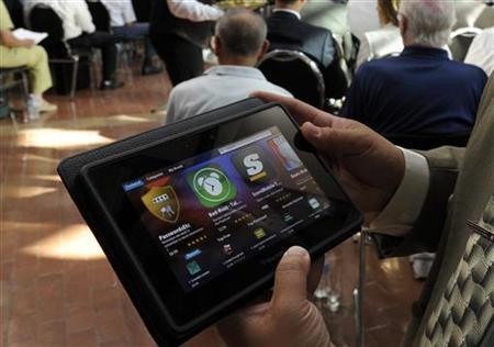 A man holds a BlackBerry PlayBook during the Research In Motion (RIM) annual general meeting of shareholders in Waterloo July 12, 2011. REUTERS/ Mike Cassese