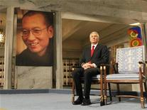 <p>Norwegian Nobel committee chairman Thorbjoern Jagland sits next to an empty chair where this year's Nobel Peace Prize winner jailed Chinese dissident Liu Xiaobo should have sat, during the ceremony at Oslo City Hall December 10, 2010. REUTERS/Heiko Junge/Scanpix Norway/Pool</p>