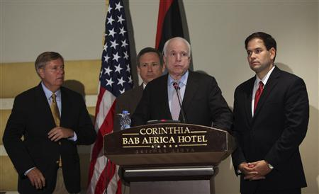 (L to R) Senators Lindsey Graham, Mark Kirk, John McCain and Marco Rubio take part in a news conference in Tripoli September 29, 2011. REUTERS/Ismail Zetouny
