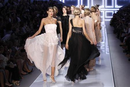 Models present creations by Bill Gaytten for Dior at the end of his Spring/Summer 2012 women's ready-to-wear fashion collection show in Paris, September 30, 2011. REUTERS/Benoit Tessier