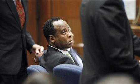 Dr. Conrad Murray watches his former patient, Robert Russell, testify during Murray's involuntary manslaughter trial in the death of pop star Michael Jackson in Los Angeles, September 30, 2011. REUTERS/Al Seib/Pool