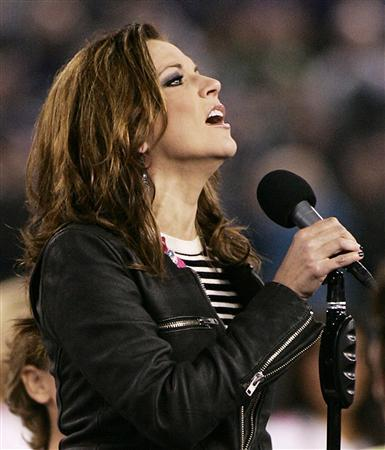 Country music entertainer Martina McBride sings the United States National Anthem before the start of the NFL game between the Baltimore Ravens and the New York Jets in Baltimore, October 2, 2011. REUTERS/Joe Giza