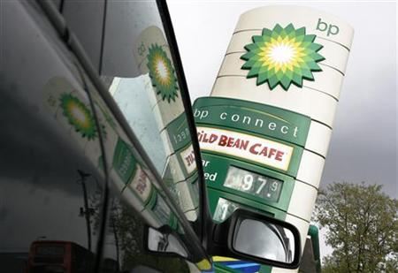 A BP petrol station is reflected in a car, in London April 28, 2009. REUTERS/Luke MacGregor