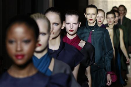 Models appear after a presentation by Italian designer Stefano Pilati for the Yves Saint Laurent Spring/Summer 2012 women's ready-to-wear fashion collection show in Paris October 3, 2011. REUTERS/Pascal Rossignol