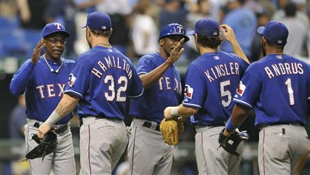 Texas Rangers players celebrate after defeating the Tampa Bay Rays in Game 3 in their MLB American League Divisional Series baseball playoffs in St. Petersburg, Florida, October 3, 2011. REUTERS/Steve Nesius