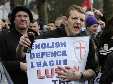 A supporter of the English Defence League gestures during a demonstration in Luton, February 5, 2011. REUTERS/Paul Hackett